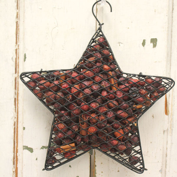 primitive wire basket with rosehips