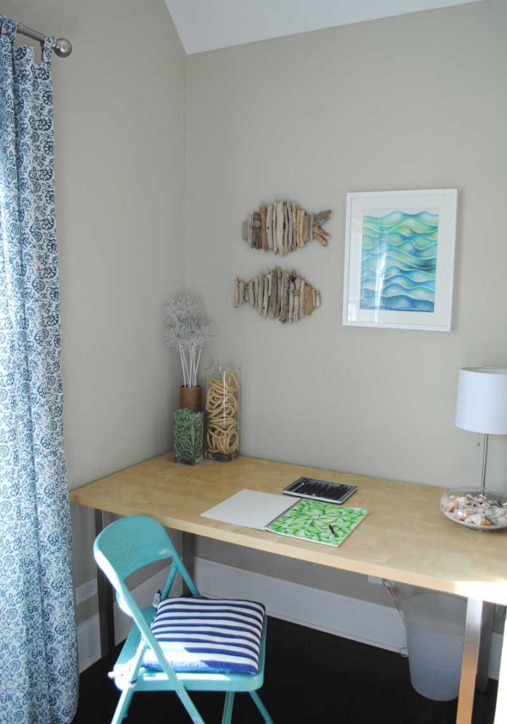 beach house desk with art