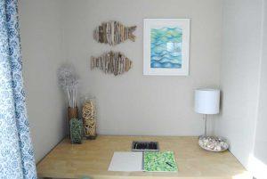 beach house desk with art