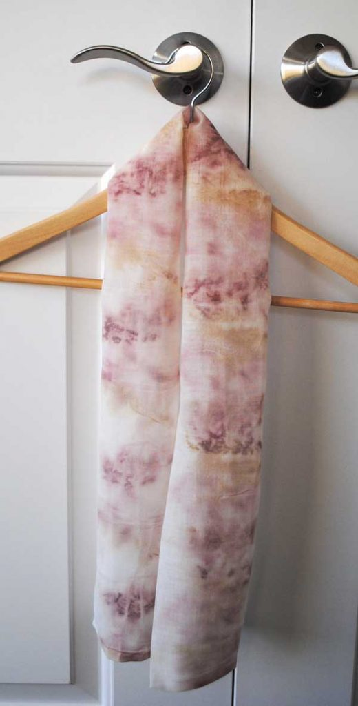 scarf created  by dyeing fabric with petals
