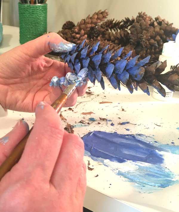 blue painted pine cones